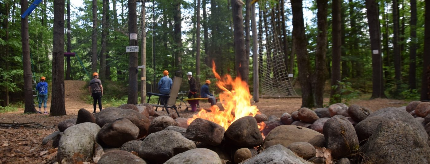 fire pit with action course in background