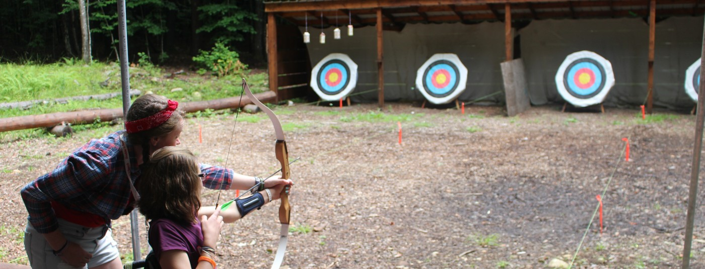 camper in wheelchair tries her luck with archery