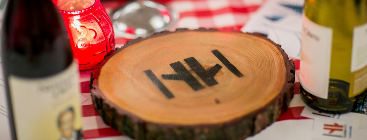 double h logo burnt on wooden coaster