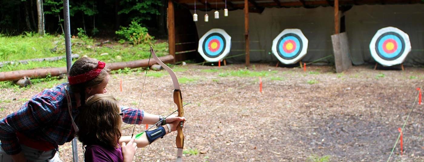 camper practicing her archery