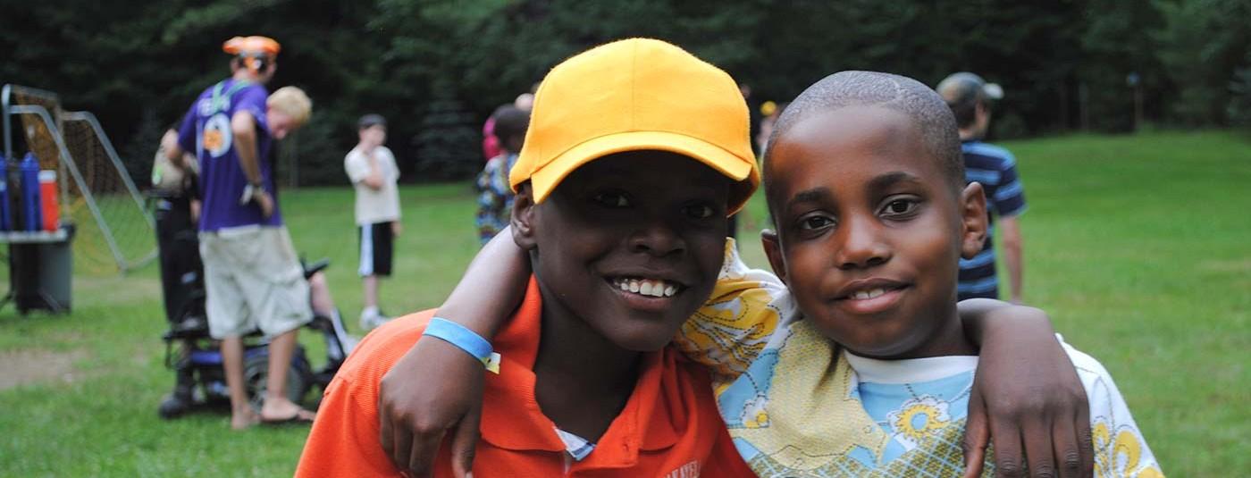 siblings smiling together at sibling camp