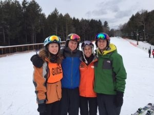 the grant family smiling on ski mountain