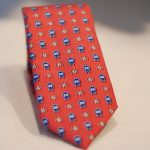 25th Anniversary Limited Edition red tie with logo.