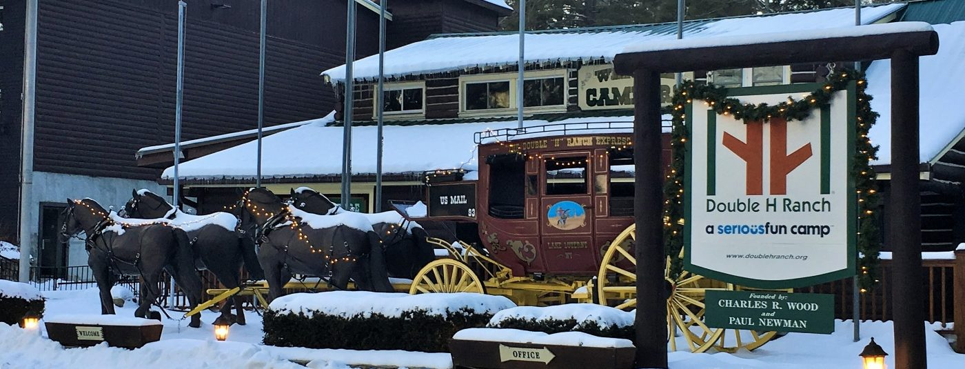 stage coach covered in snow with holiday lights