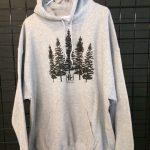 grey sweatshirt with pine trees