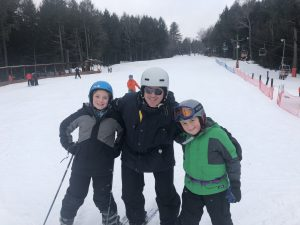 campers and dad on ski hill