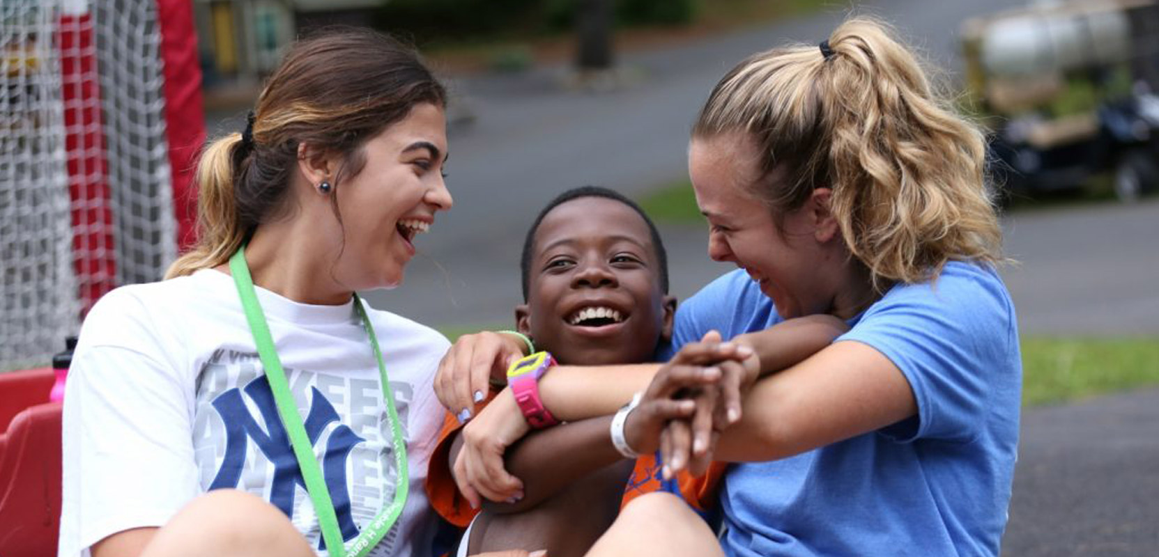 counselors and camper laughing