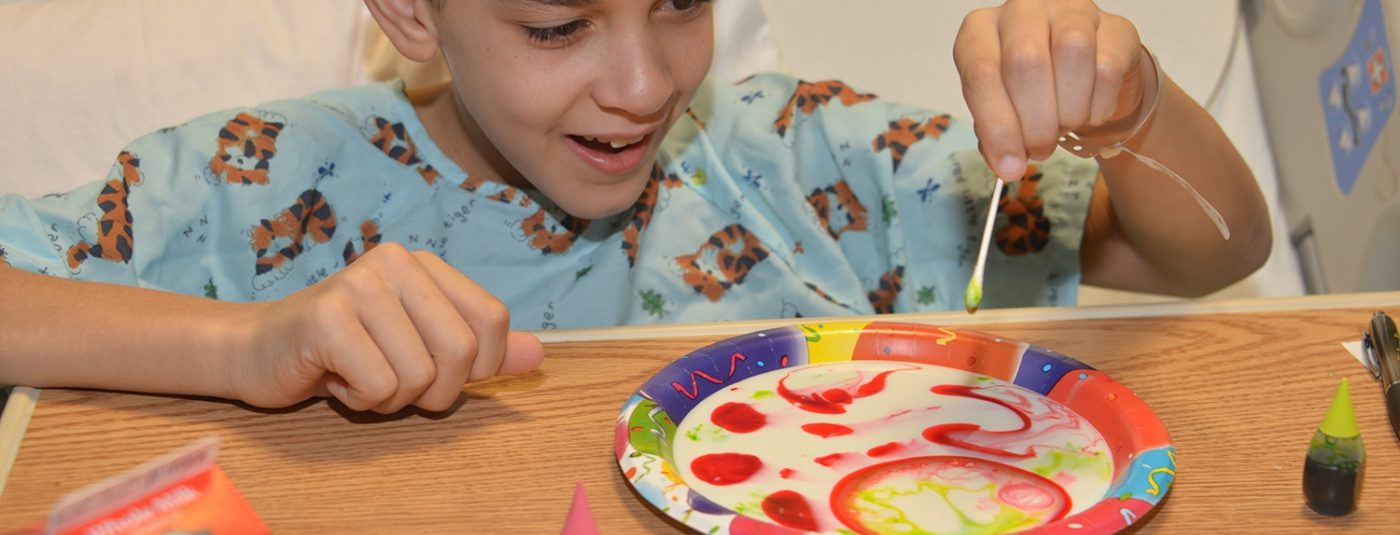camper making art in medical based setting