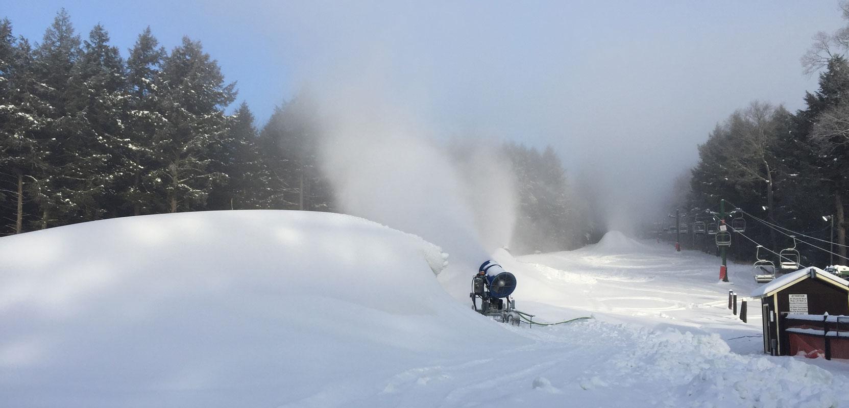 Snowmaker blowing fresh made snow