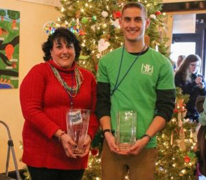 volunteers of year smiling and holing awards