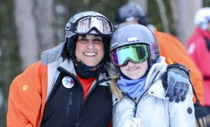 instructor and skier with goggles smiling