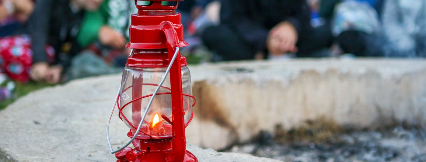 red lantern by campfire