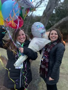 volunteers holding balloons