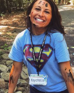 counselor wearing superman shirt and paint on arms
