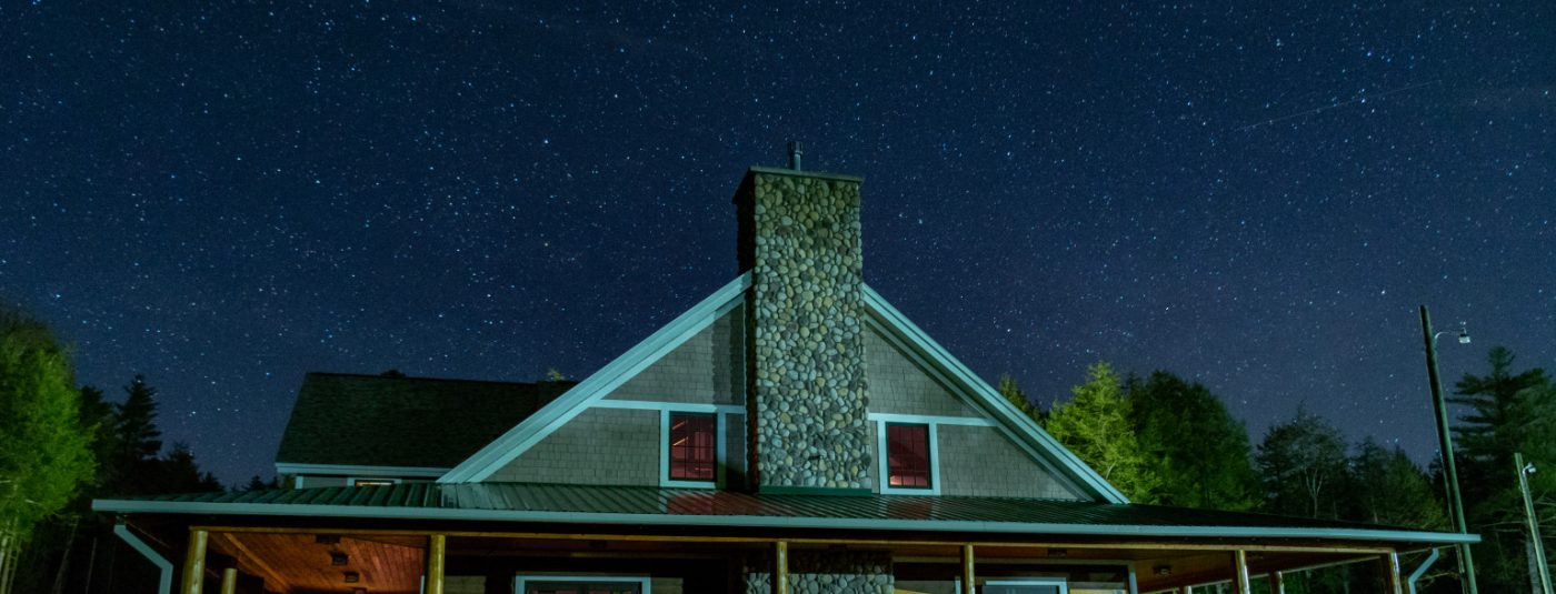 cabin with starry night sky