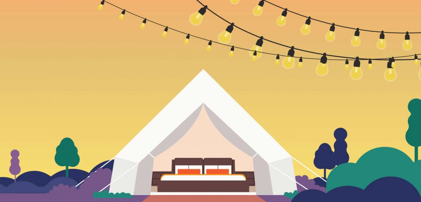 tent with decorative lights and trees